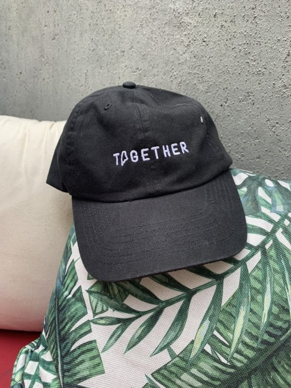 together hat sitting on a pillow for Maine fundraiser