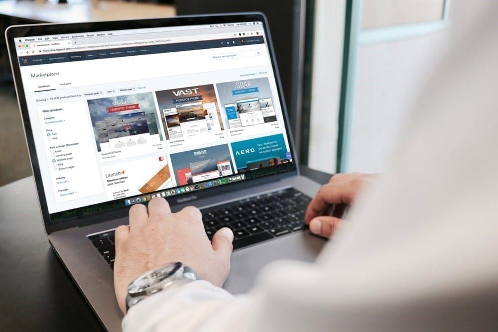 Man going through an online marketplace.